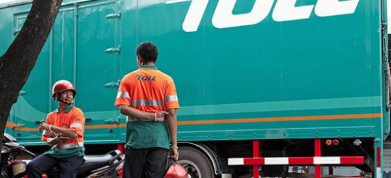 Toll employees with a truck and motorcycle in Thailand