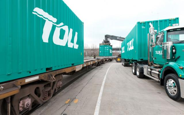Unloading containers from a Toll truck