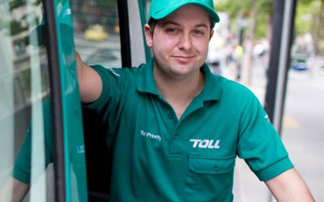 Toll employee delivering parcels